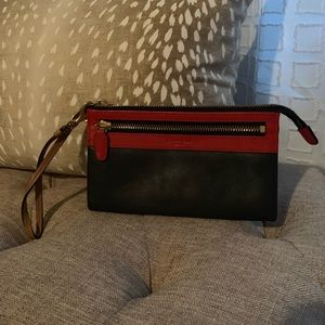 Navy and red leather Coach clutch.